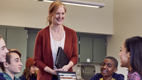 image of  teacher talking to students in a classroom