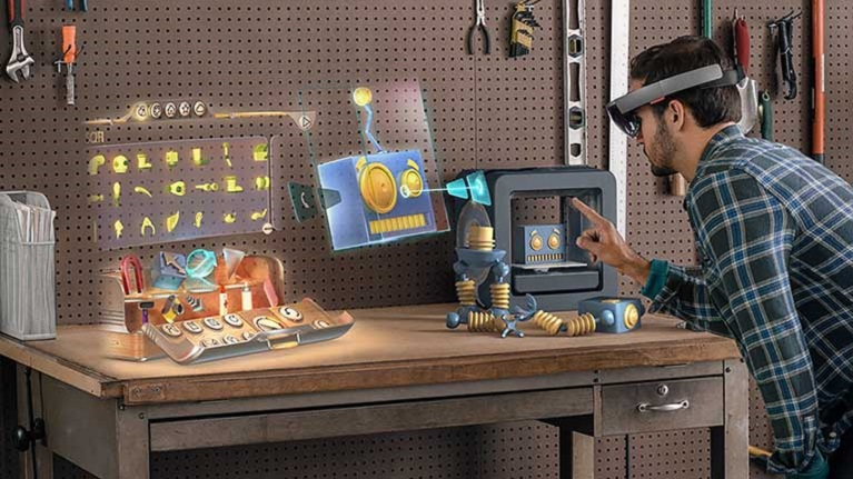 Image of man creating a robot with HoloLens.